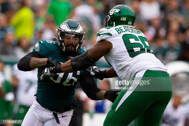 Derek Barnett of the Philadelphia Eagles rushes the passer against Kelvin Beachum of the New York Jets at Lincoln Financial Field on October 6, 2019...