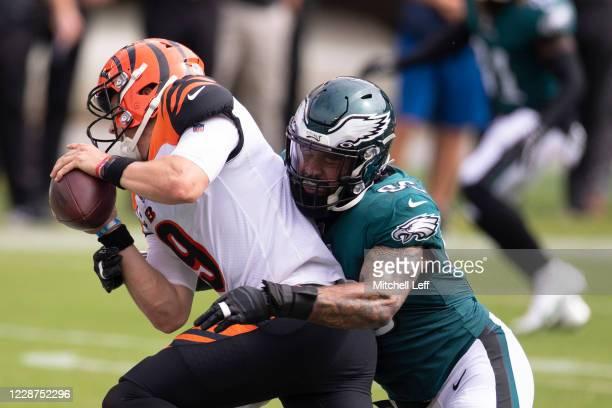 Derek Barnett of the Philadelphia Eagles sacks Joe Burrow of the Cincinnati Bengals in the second quarter at Lincoln Financial Field on September 27,...