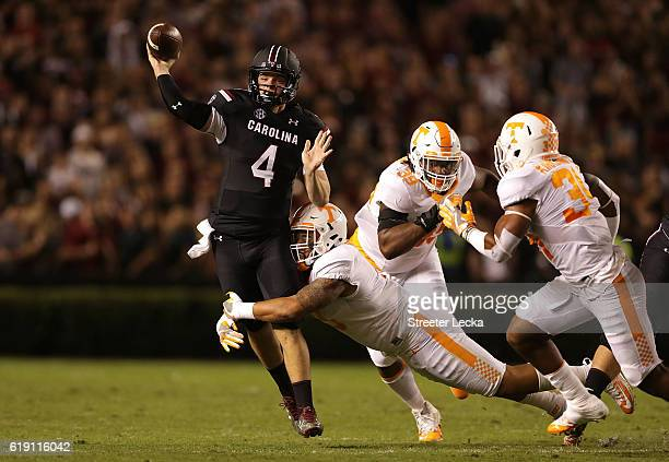 Derek Barnett of the Tennessee Volunteers tries to stop Jake Bentley of the South Carolina Gamecocks during their game at WilliamsBrice Stadium on...