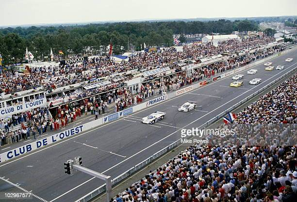 Derek Bell drives the Rothmans Porsche Racing Porsche 962C down the front straight at the start of the World Endurance Championship 24 Hours of Le...