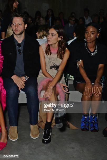 Derek Blasberg Alexa Chung and Pippa BennettWarner attend the Christopher Kane front row during London Fashion Week September 2018 at the Tate Modern...