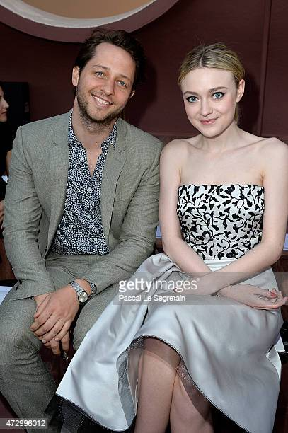 Derek Blasberg and Dakota Fanning attend the Dior Croisiere 2016 at Palais Bulle on May 11 2015 in Theoule sur Mer France