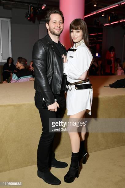Derek Blasberg and Hailee Steinfeld attend the Prada Resort 2020 fashion show at Prada Headquarters on May 02 2019 in New York City