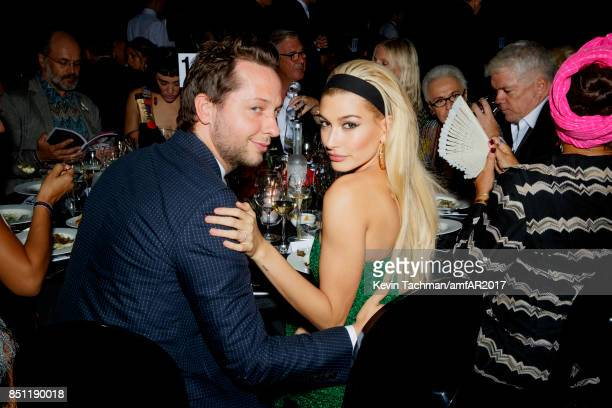 Derek Blasberg and Hailey Baldwin attend the dinner at the amfAR Gala Milano on September 21 2017 in Milan Italy