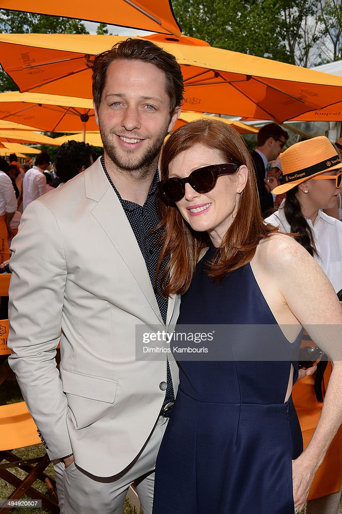 Derek Blasberg and Julianne Moore attend the seventh annual Veuve Clicquot Polo Classic in Liberty State Park on May 31, 2014 in Jersey City City.