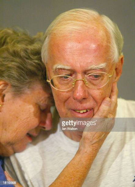 Derek Bond with his wife Audrey addresses the media after being released by local police authorities on February 26 2003 in Durban South Africa Mr...