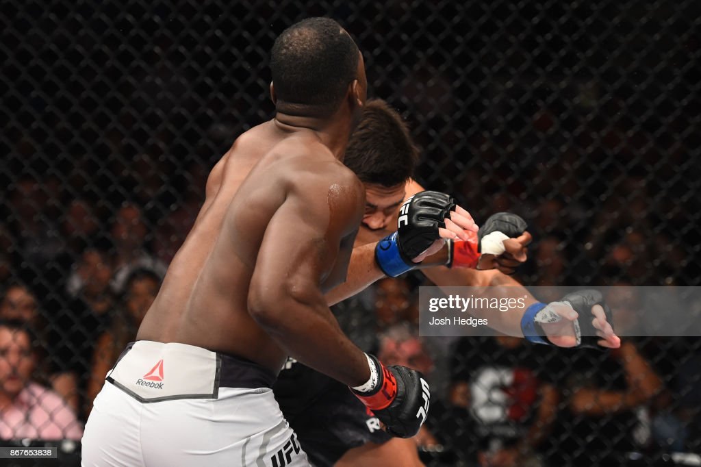 Derek Brunson punches Lyoto Machida of Brazil in their middleweight bout during the UFC Fight Night event inside the Ibirapuera Gymnasium on October 28, 2017 in Sao Paulo, Brazil.