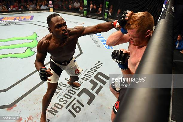 Derek Brunson punches Sam Alvey in their middleweight bout during the UFC Fight Night event at Bridgestone Arena on August 8 2015 in Nashville...