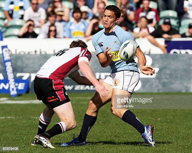 Derek Carpenter of Northland passes the ball before Jack McPhee of North Harbour makes a tackle during the Air New Zealand Cup match between North...