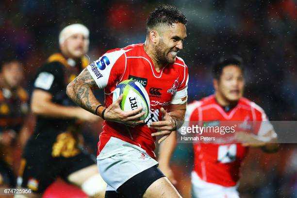 Derek Carpenter of the Sunwolves makes a break to score a try during the round 10 Super Rugby match between the Chiefs and the Sunwolves at FMG...
