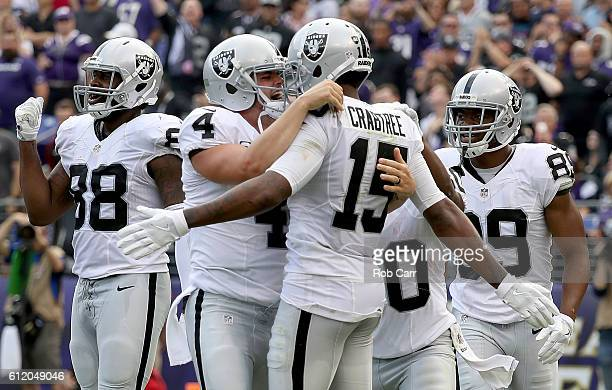 Derek Carr and Michael Crabtree of the Oakland Raiders celebrate after scoring a touchdown in the fourth quarter against the Baltimore Ravens at MT...