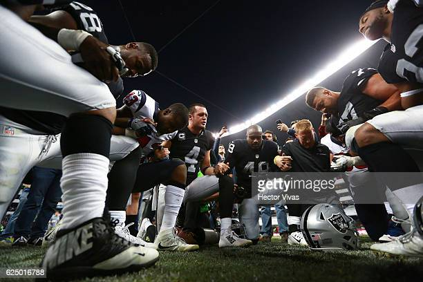 Derek Carr of Oakland Raiders celebrates with teammates after winning the NFL football game between Houston Texans and Oakland Raiders at Azteca...