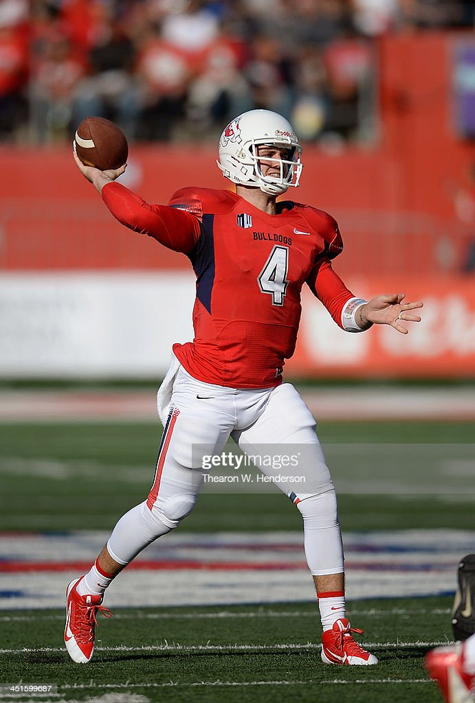 Derek Carr #4 of the Fresno State Bulldogs drops back to pass against the New Mexico Lobos during the first quarter at Bulldog Stadium on November 23, 2013 in Fresno, California.
