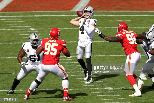 Derek Carr of the Las Vegas Raiders attempts a pass against the Kansas City Chiefs during the first quarter at Arrowhead Stadium on October 11, 2020...