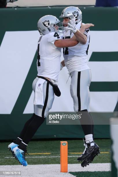 Derek Carr of the Las Vegas Raiders celebrates his touchdown with Foster Moreau during the second half against the New York Jets at MetLife Stadium...