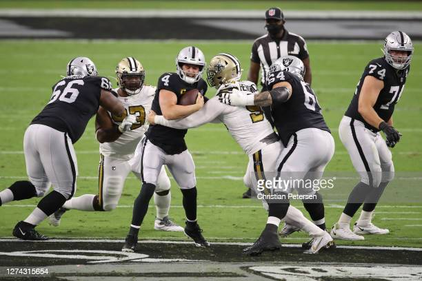 Derek Carr of the Las Vegas Raiders is sacked by Trey Hendrickson of the New Orleans Saints during the first quarter against the New Orleans Saints...