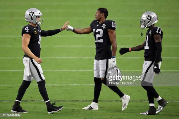 Derek Carr of the Las Vegas Raiders reacts with Zay Jones and Henry Ruggs III against the New Orleans Saints at Allegiant Stadium on September 21...