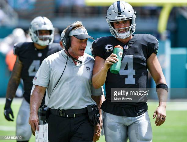 Derek Carr of the Oakland Raiders and head coach Jon Gruden of the Oakland Raiders during the second quarter against Miami Dolphins at Hard Rock...