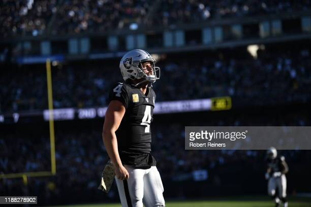 Derek Carr of the Oakland Raiders celebrate after scoring in the second quarter against the Cincinnati Bengals during their NFL game at RingCentral...