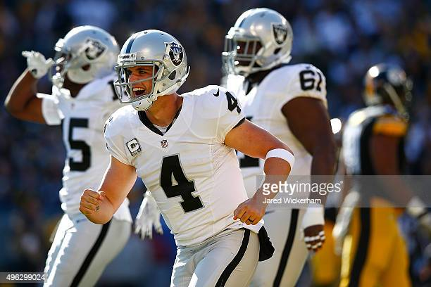Derek Carr of the Oakland Raiders celebrates a first quarter touchdown in the first quarter of the game against the Pittsburgh Steelers at Heinz...
