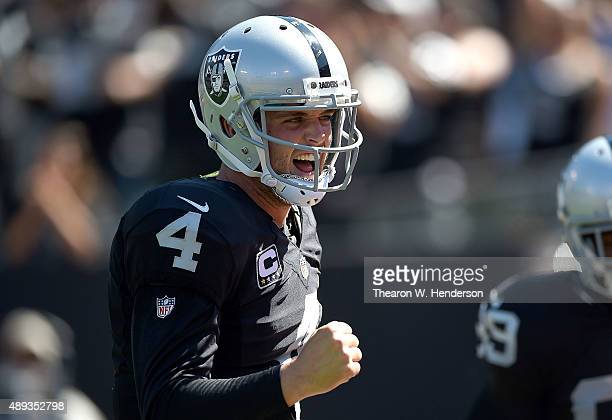 Derek Carr of the Oakland Raiders celebrates a touchdown in the first quarter against the Baltimore Ravens at Oakland-Alameda County Coliseum on...