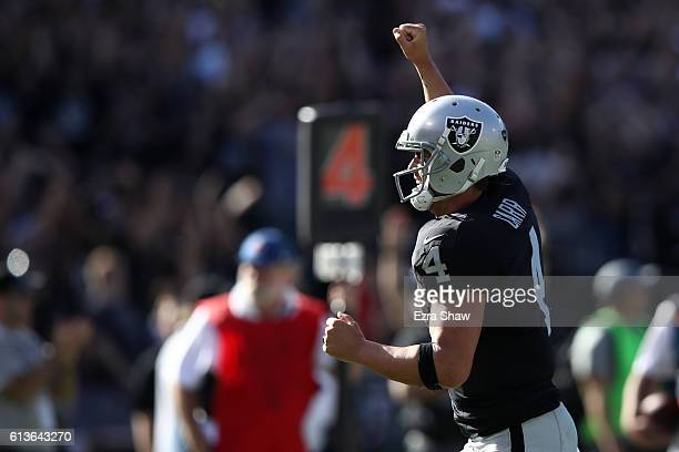 Derek Carr of the Oakland Raiders celebrates after a a 21yard pass to Michael Crabtree for a touchdown against the San Diego Chargers during their...