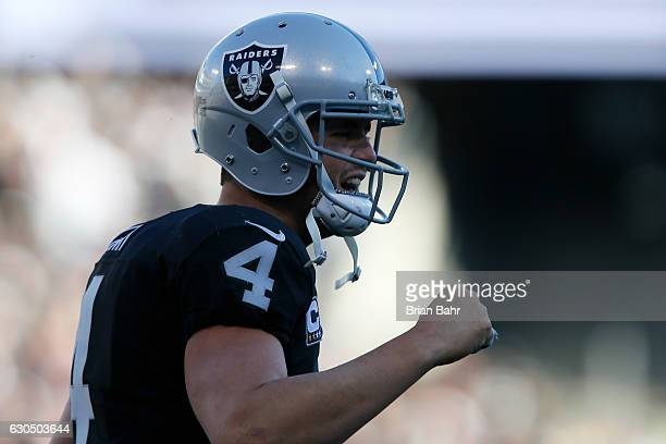 Derek Carr of the Oakland Raiders celebrates after a DeAndre Washington 22yard touchdown against the Indianapolis Colts during their NFL game at...