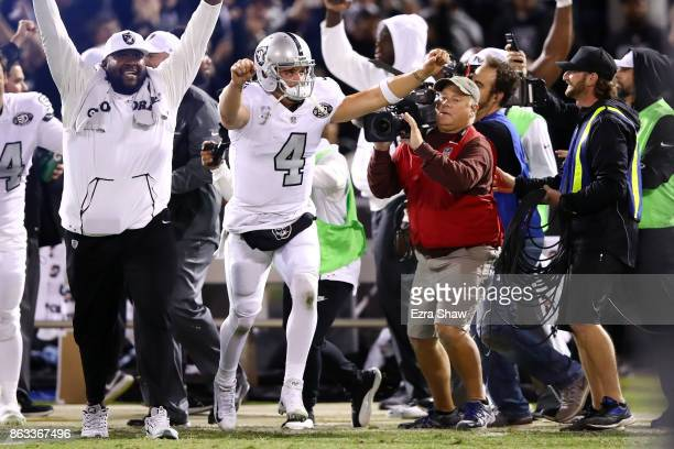 Derek Carr of the Oakland Raiders celebrates after a Giorgio Tavecchio extra point is good to defeat the Kansas City Chiefs 3130 in their NFL game at...