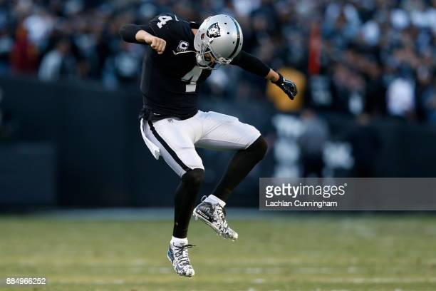 Derek Carr of the Oakland Raiders celebrates after a nineyard touchdown pass to Johnny Holton in the fourth quarter of their NFL game against the New...