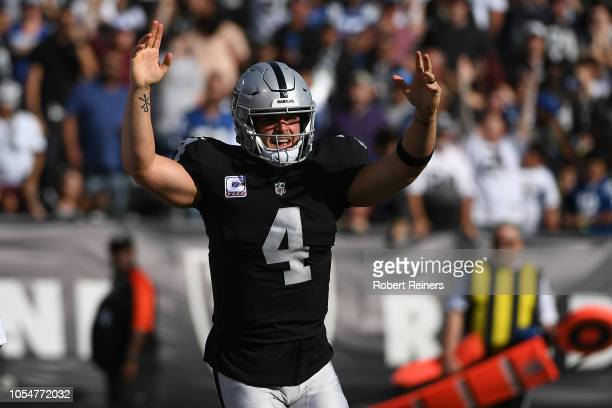 Derek Carr of the Oakland Raiders celebrates after a one-yard touchdown against the Indianapolis Colts during their NFL game at Oakland-Alameda...