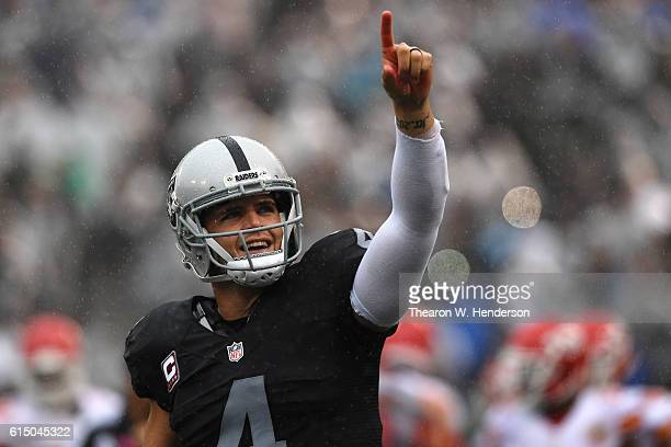 Derek Carr of the Oakland Raiders celebrates after a threeyard touchdown pass to Andre Holmes during their NFL game against the Kansas City Chiefs at...