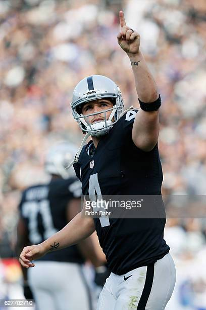 Derek Carr of the Oakland Raiders celebrates after a three-yard touchdown pass against the Buffalo Bills during their NFL game at Oakland Alameda...