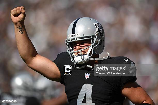 Derek Carr of the Oakland Raiders celebrates after a two-yard touchdown pass against the Atlanta Falcons during their NFL game at Oakland-Alameda...