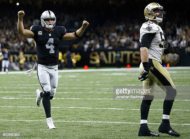 Derek Carr of the Oakland Raiders celebrates after completing a twopoint conversion to take the lead during the second half of a game against the New...