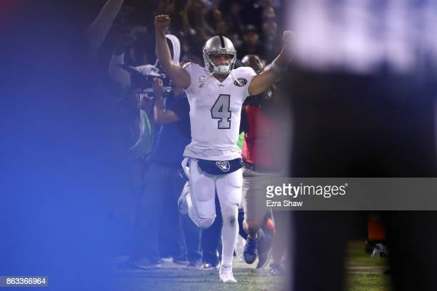 Derek Carr of the Oakland Raiders celebrates after defeating the Kansas City Chiefs 3130 in their NFL game at OaklandAlameda County Coliseum on...