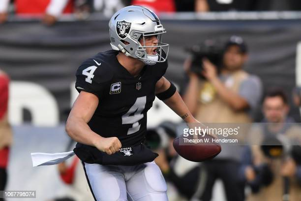 Derek Carr of the Oakland Raiders celebrates after scoring on a nine-yard pass to Marcell Ateman against the Kansas City Chiefs during their NFL game...