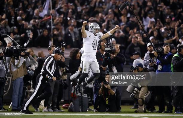 Derek Carr of the Oakland Raiders celebrates after the Raiders intercepted a pass on fourth down at the end of the fourth quarter to clinch their...