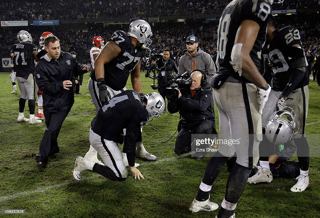 Derek Carr #4 of the Oakland Raiders celebrates after the Raiders beat the Kansas City Chiefs for their first win of the season at O.co Coliseum on November 20, 2014 in Oakland, California.