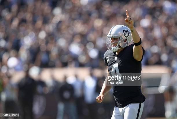 Derek Carr of the Oakland Raiders celebrates after the Raiders scored a touchdown against the New York Jets at OaklandAlameda County Coliseum on...
