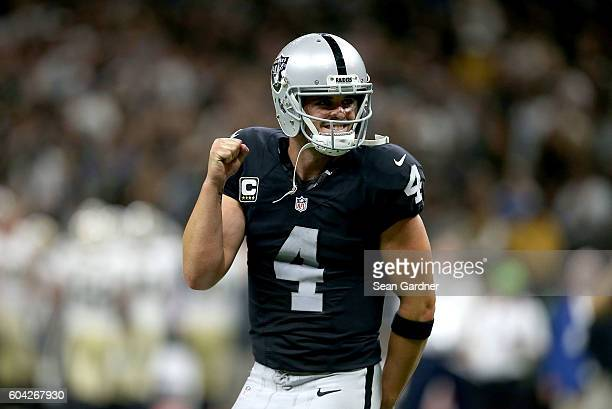 Derek Carr of the Oakland Raiders celebrates after throwing a touchdown pass against the New Orleans Saints during the fourth quarter at the...