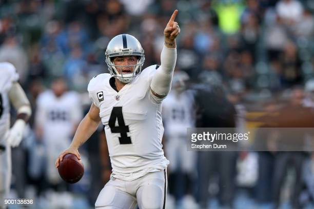 Derek Carr of the Oakland Raiders directs his team before throwing the ball during the second half of the game against the Los Angeles Chargers at...