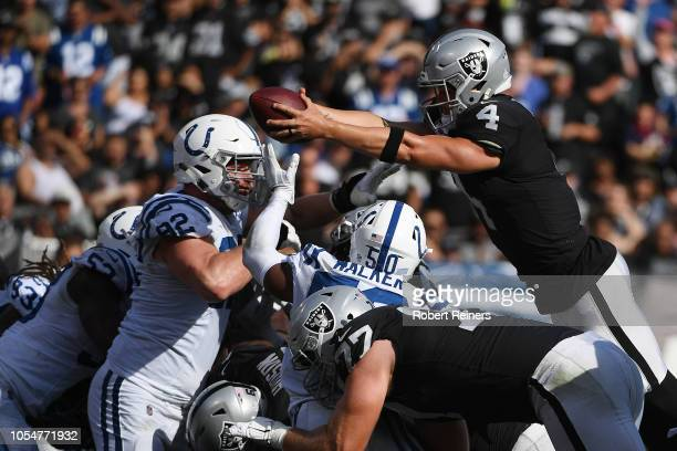 Derek Carr of the Oakland Raiders dives for a oneyard touchdown against the Indianapolis Colts during their NFL game at OaklandAlameda County...
