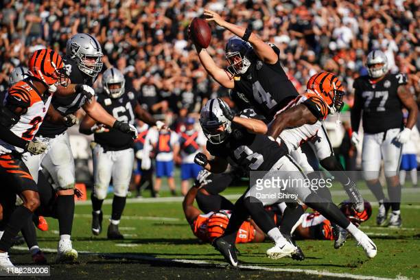 Derek Carr of the Oakland Raiders dives into the end zone for a touchdown during the first half against the Cincinnati Bengals at RingCentral...