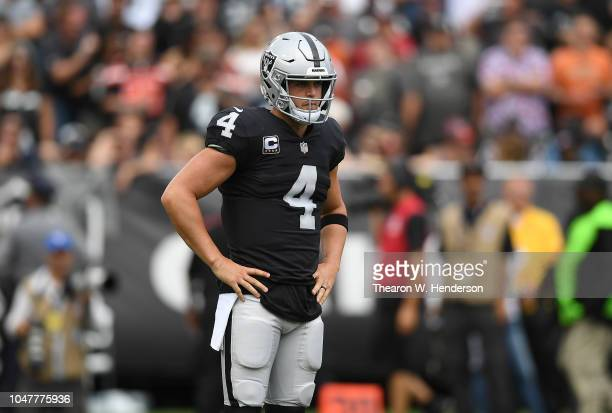 Derek Carr of the Oakland Raiders drops looks on against the Cleveland Browns during the third quarter of their NFL fooball game at OaklandAlameda...