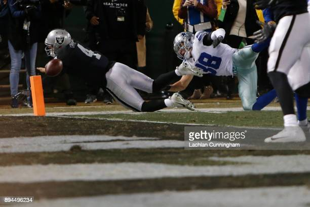 Derek Carr of the Oakland Raiders fumbles the ball into the end zone for a Dallas Cowboys touchback in the fourth quarter of their NFL game at...