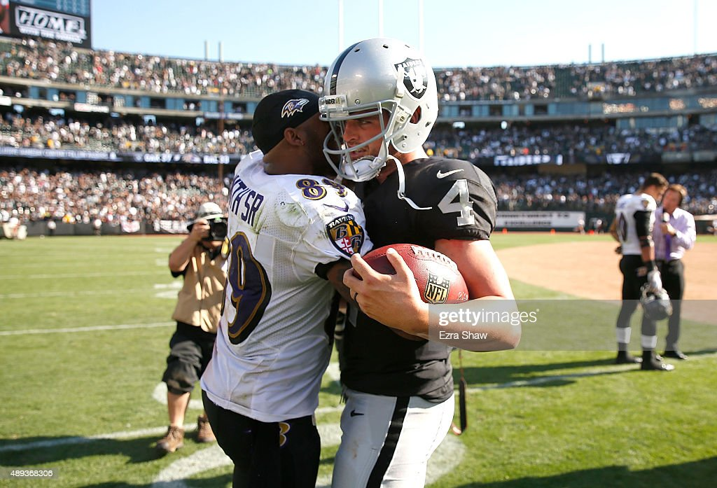 Derek Carr #4 of the Oakland Raiders greets Steve Smith #89 of the Baltimore Ravens after a win over the Baltimore Ravens at Oakland-Alameda County Coliseum on September 20, 2015 in Oakland, California.