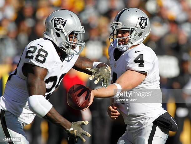 Derek Carr of the Oakland Raiders in action during the game against the Pittsburgh Steelers on November 8 2015 at Heinz Field in Pittsburgh...