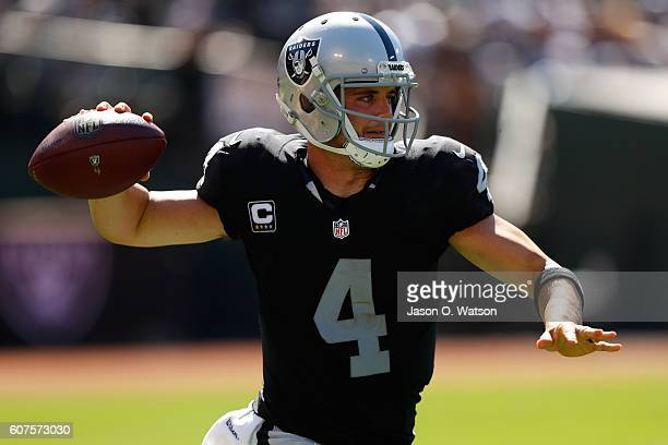 Derek Carr of the Oakland Raiders looks to pass against the Atlanta Falcons during their NFL game at OaklandAlameda County Coliseum on September 18...