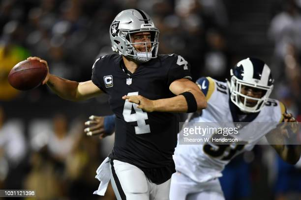 Derek Carr of the Oakland Raiders looks to pass against the Los Angeles Rams during their NFL game at Oakland-Alameda County Coliseum on September...