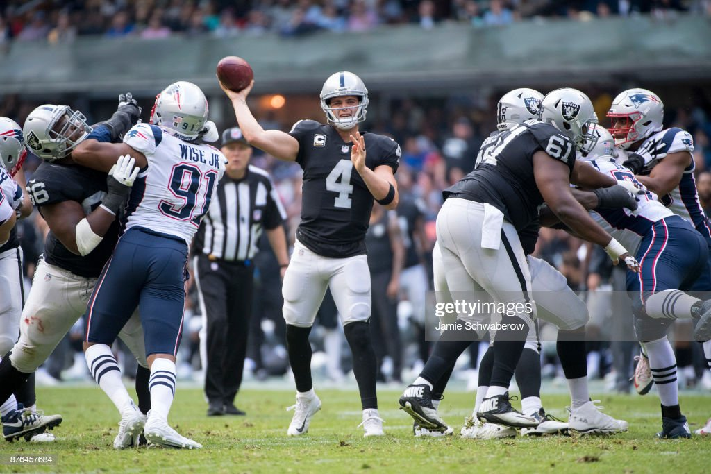 Derek Carr #4 of the Oakland Raiders passes against the New England Patriots at Estadio Azteca on November 19, 2017 in Mexico City, Mexico.